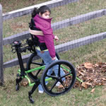Girl in standing wheelchair with Angelman Syndrome